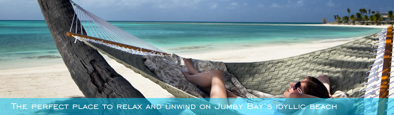Relaxing on the beach at Jumby Bay